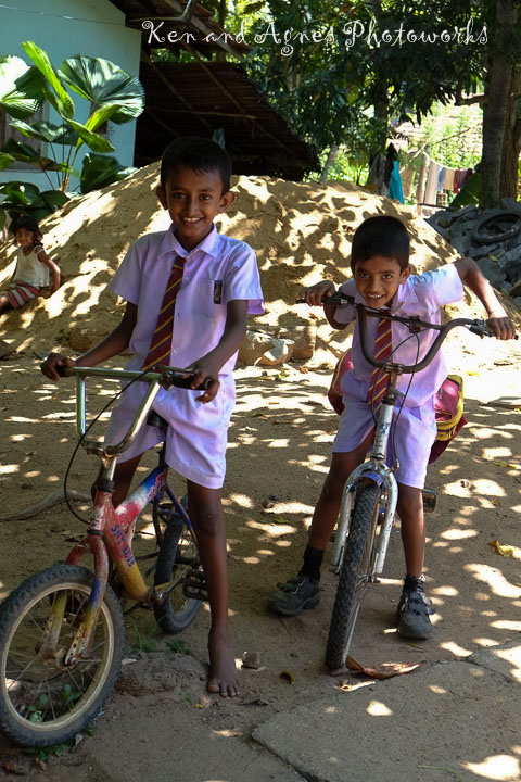 Schoolboys On Bike