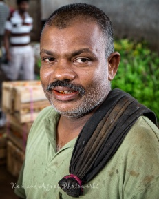 A Workmen With Stained Teeth From Chewing Areca Nut and Betel Leaves To Refresh Themselves And Stay Alert