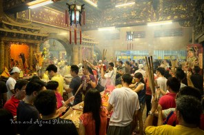 Devotees patiently queue and wait for their turn to pray to the gods in the outer prayer hall, unfazed by the thick mist of incense smoke making breathing difficult and eyes teary.