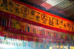Adorning the makeshift shelter in the temple forecourt were these colourful banners beautifully embroided with folk art, floral motifs, 'The Nine Emperor Gods' in Chinese text and fringed with colourful string tassels.